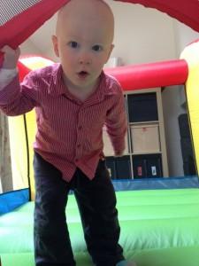 Joseph in a mini bouncy castle